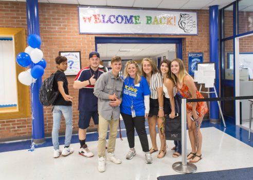 Students pictured with Ms. Intrieri on first days of school